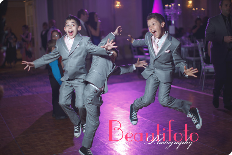 Kids jumping with joy at the Crown Plaza reception hall.